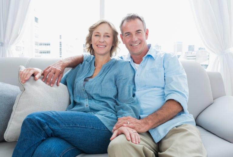 caucasian man and woman smiling